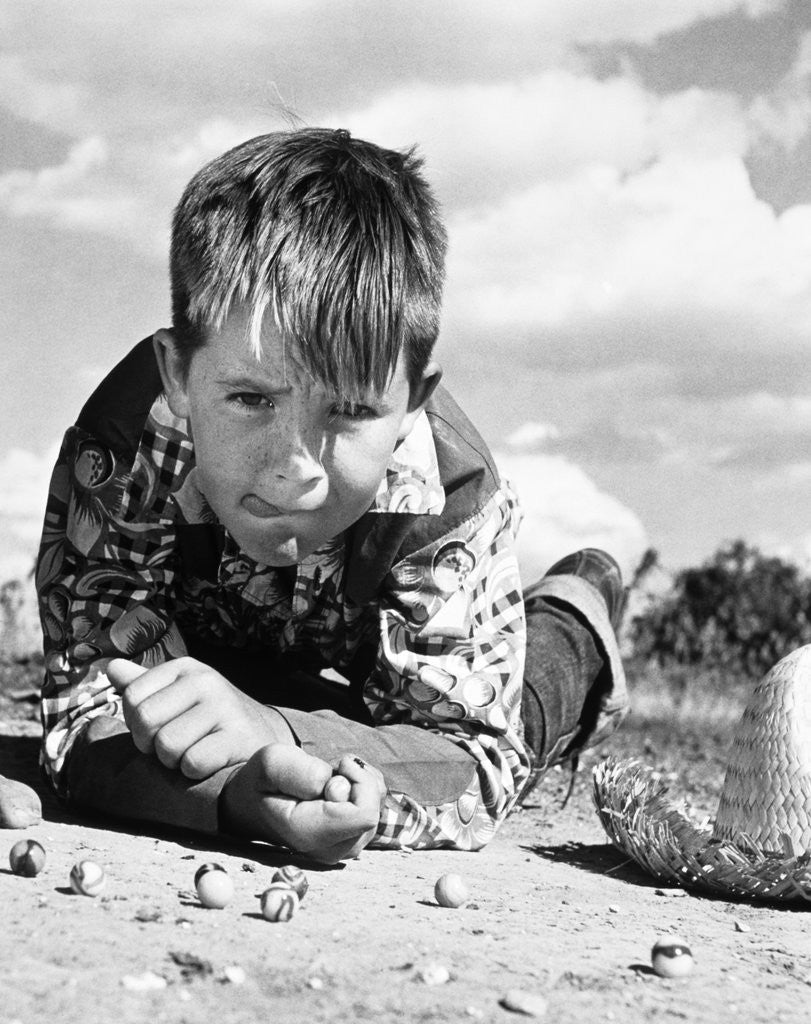 Detail of 1950s Boy Shooting Marbles Outdoor by Corbis