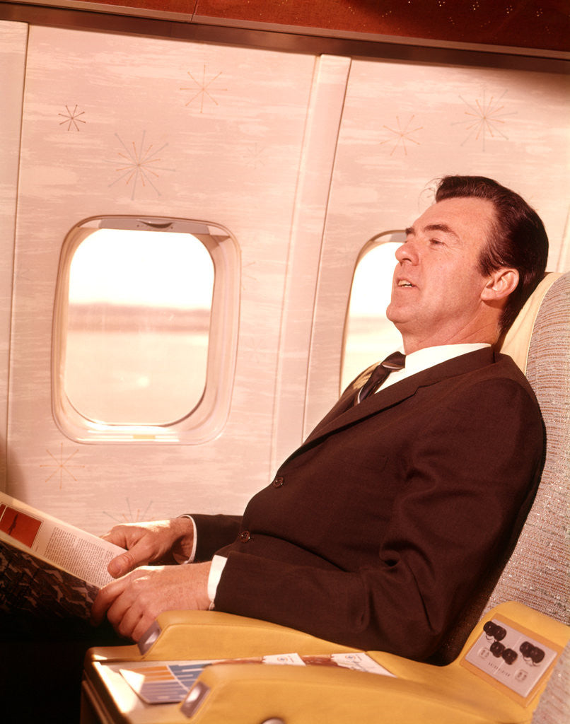 Detail of 1960s Man Sitting In First Class Airplane Passenger Seat by Corbis