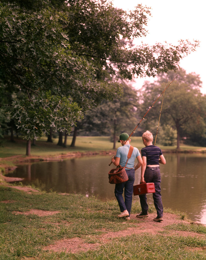 Detail of 1970s 1960s Two Boys Walking Beside Fishing Pond by Corbis