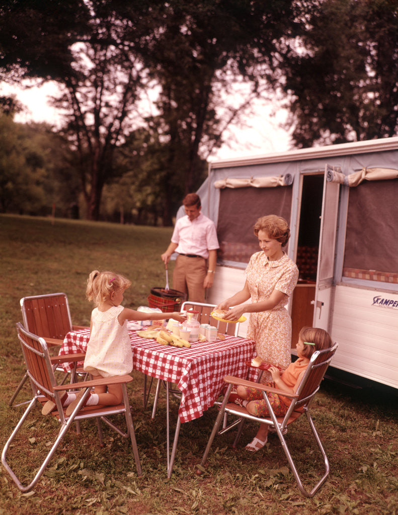 Detail of 1960s Family Rv Camping Father Grilling Mother And Girls Setting Table by Corbis