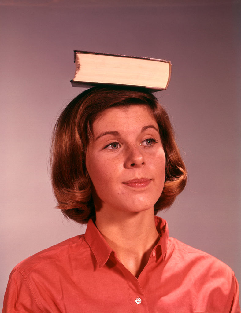 Detail of 1960s 1970s Young Woman Girl Balancing Book On Head by Corbis