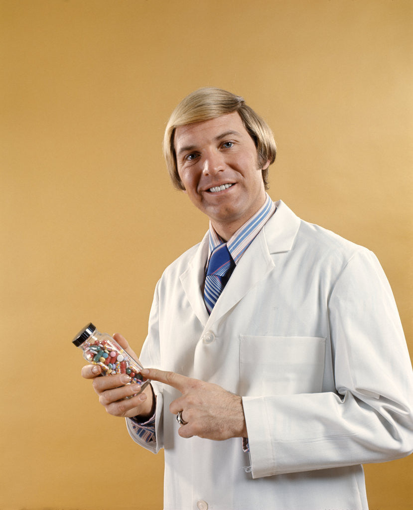 1960s 1970s Man Doctor Pharmacist White Jacket Holding Bottle Pills by Corbis
