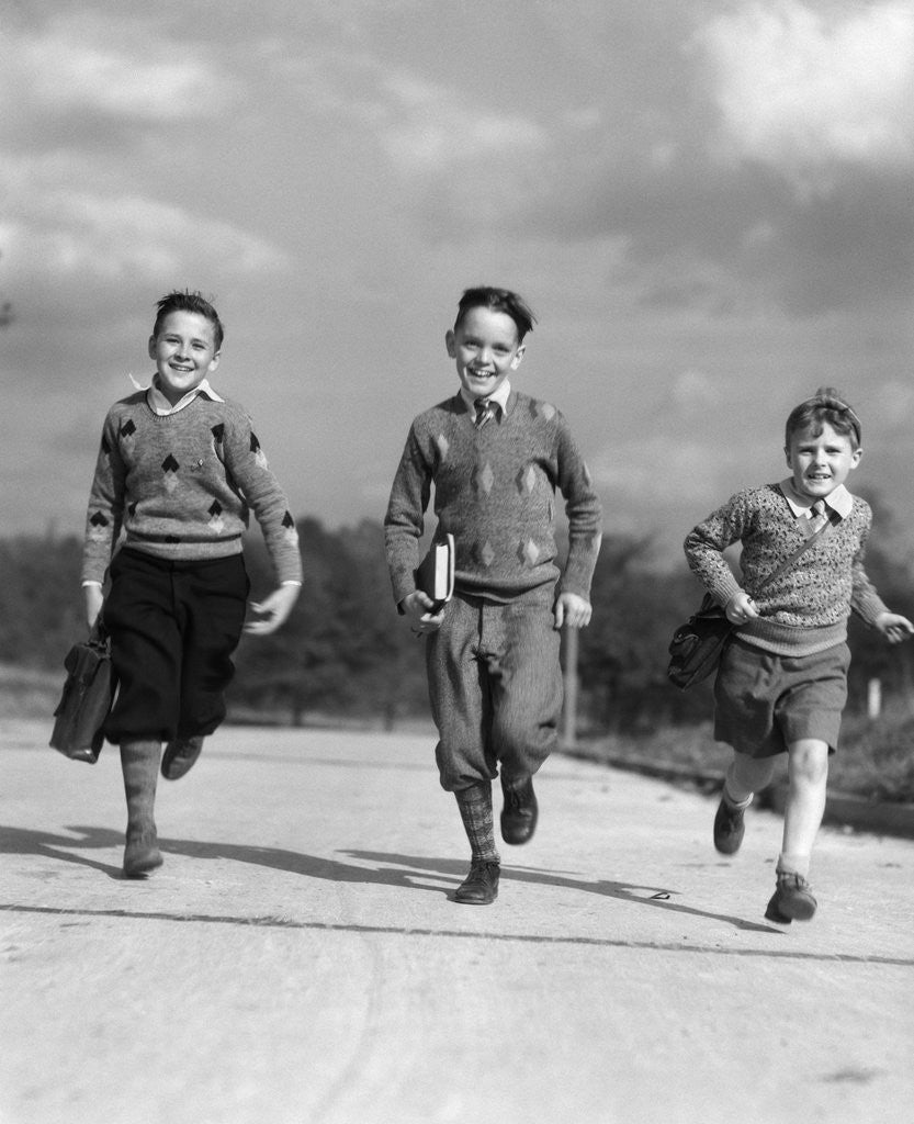 Detail of 1930s Three Boys Running School Books by Corbis