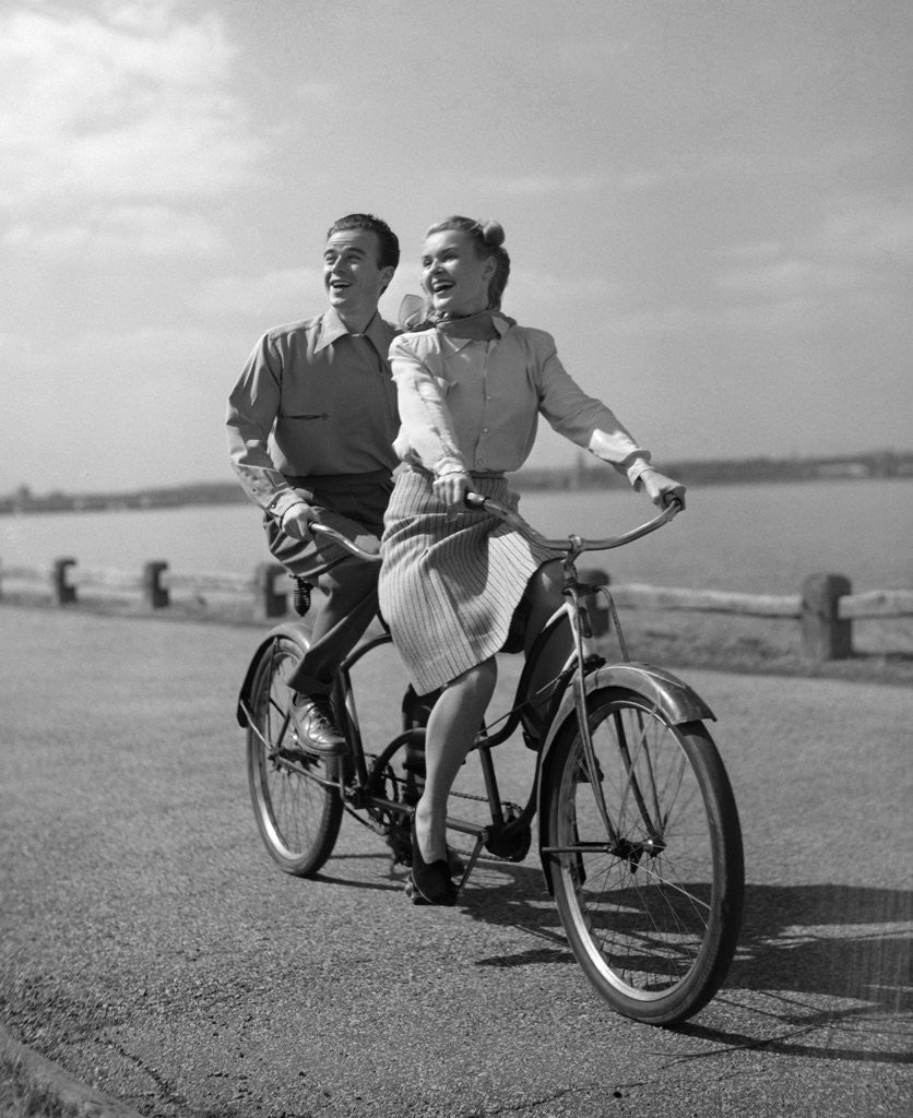 Detail of 1950s Happy Couple Man Woman Riding Tandem Bike Bicycle Built For 2 by Corbis