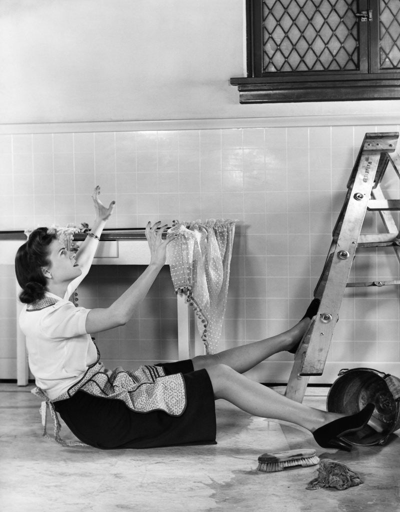 Detail of 1940s Woman Housewife Falling From Step Ladder In Kitchen While Washing Window by Corbis