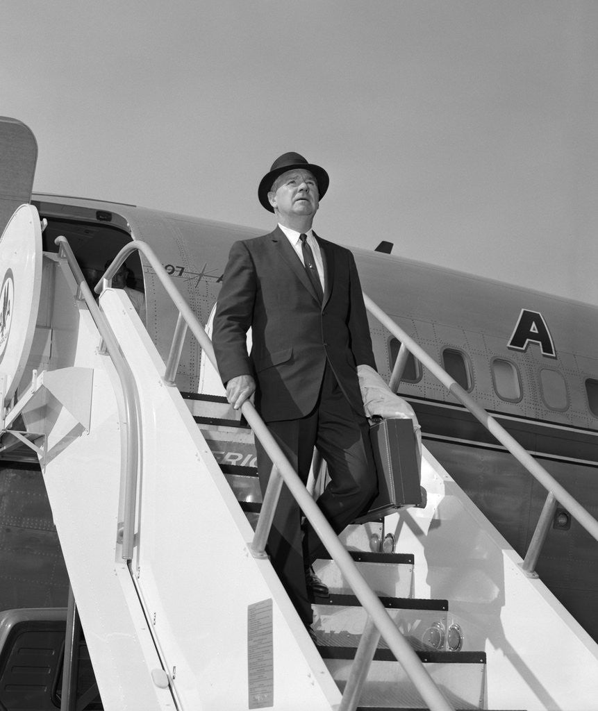 Detail of 1960s Businessman Deplaning From Airplane Wearing Hat And Carrying Overcoat And Briefcase by Corbis