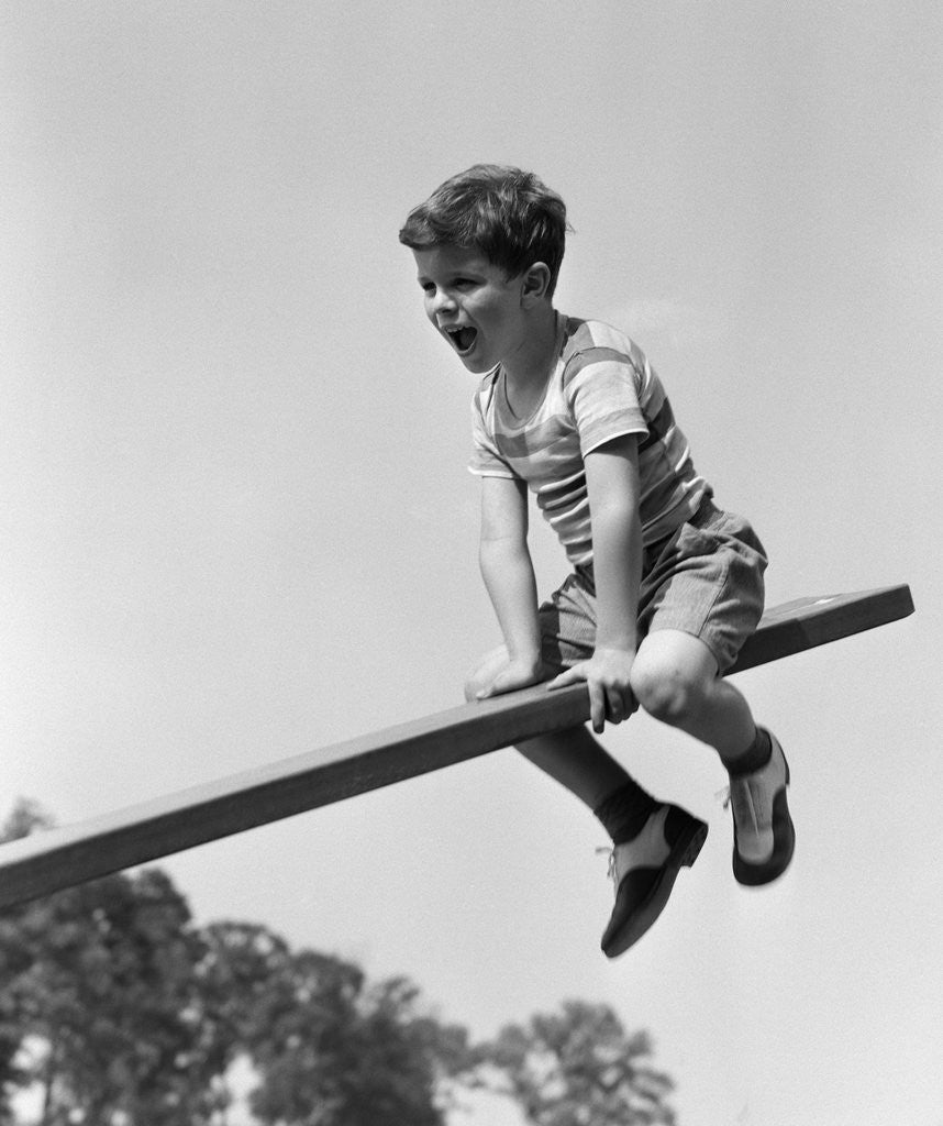 1930s 1940s Excited Boy On Seesaw Playing