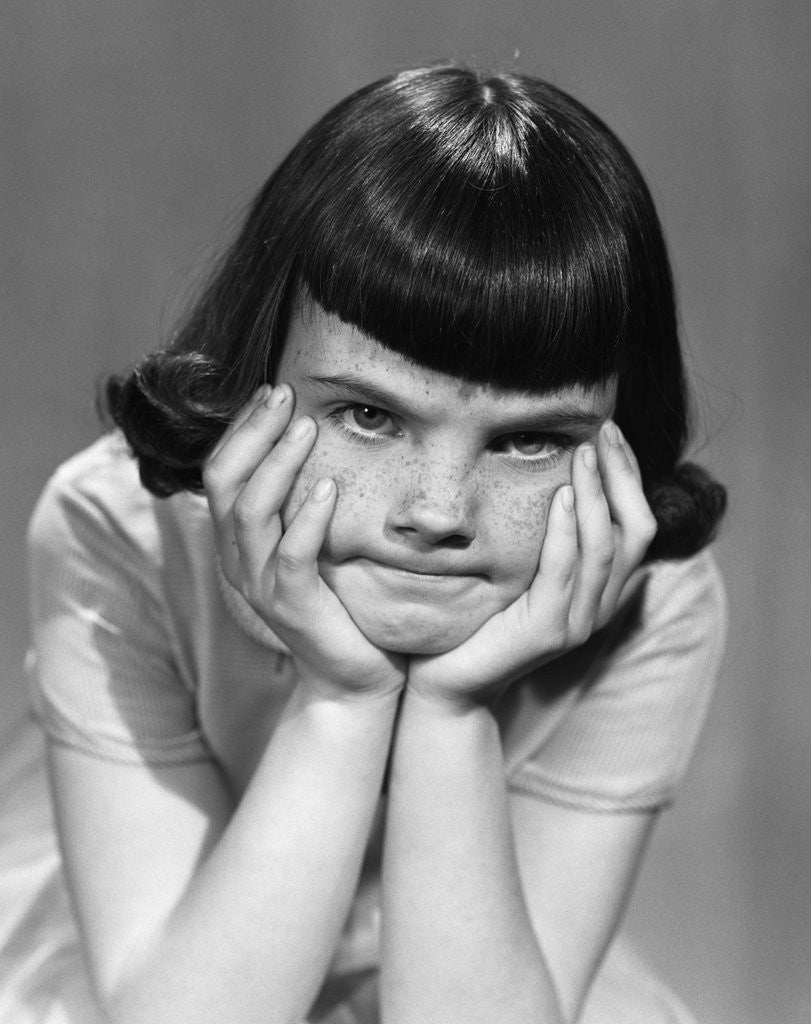 Detail of 1950s Mad Angry Frustrated Girl Head Resting In Hands by Corbis