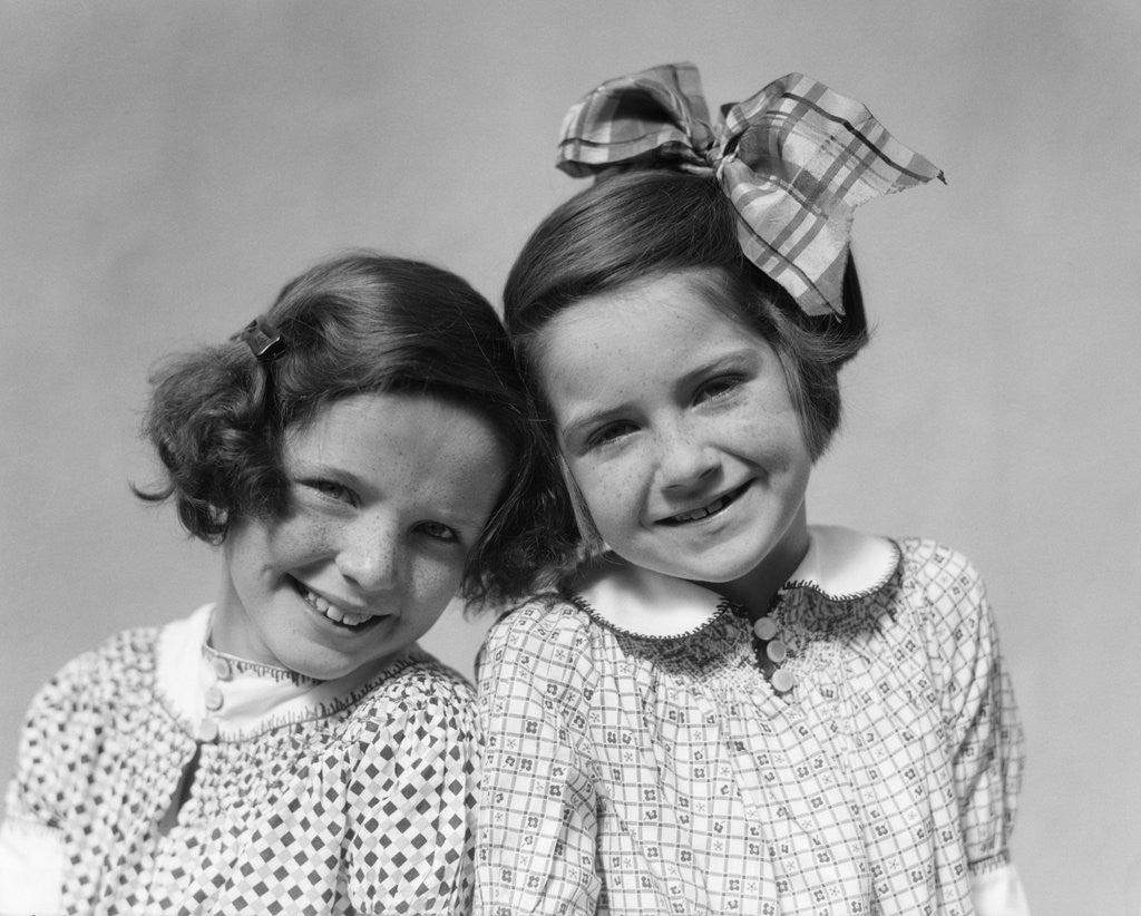 Detail of 1920s 1930s Portrait Two Girls Head To Head by Corbis