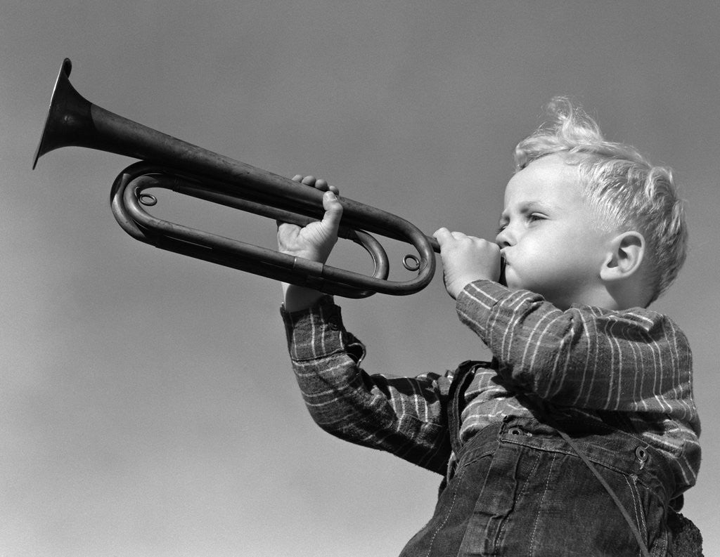 Detail of 1940s Boy Blowing Bugle Outdoor by Corbis