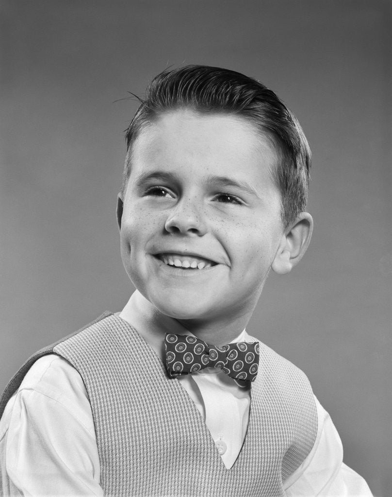 Detail of 1950s Boy Portrait Wearing Checked Vest Polka Dot Bow Tie School Picture by Corbis