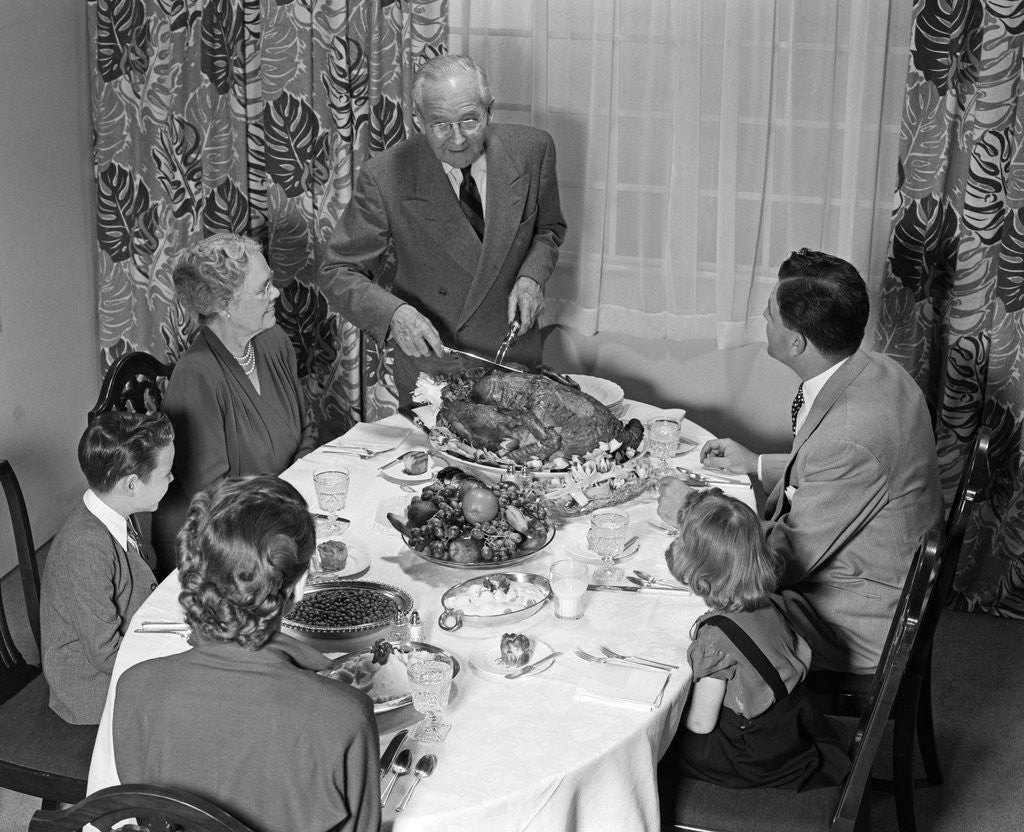 Detail of 1940s 1950s 3 Generation Family Meal Dining Room Table Grandfather Carving Turkey by Corbis
