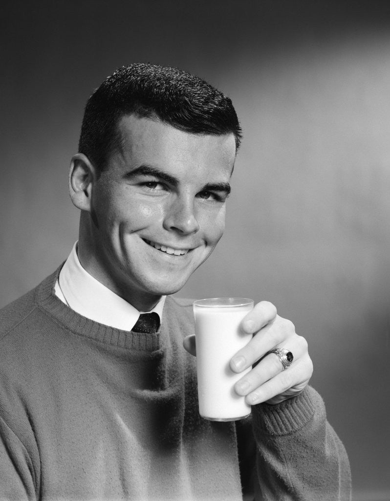 Detail of 1960s Young Man Holding Glass Of Milk by Corbis