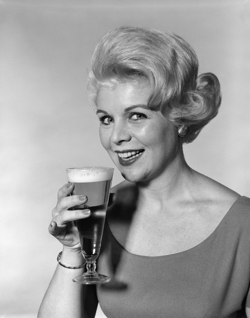 Detail of 1960s Retro Woman Beer Glass Smile by Corbis