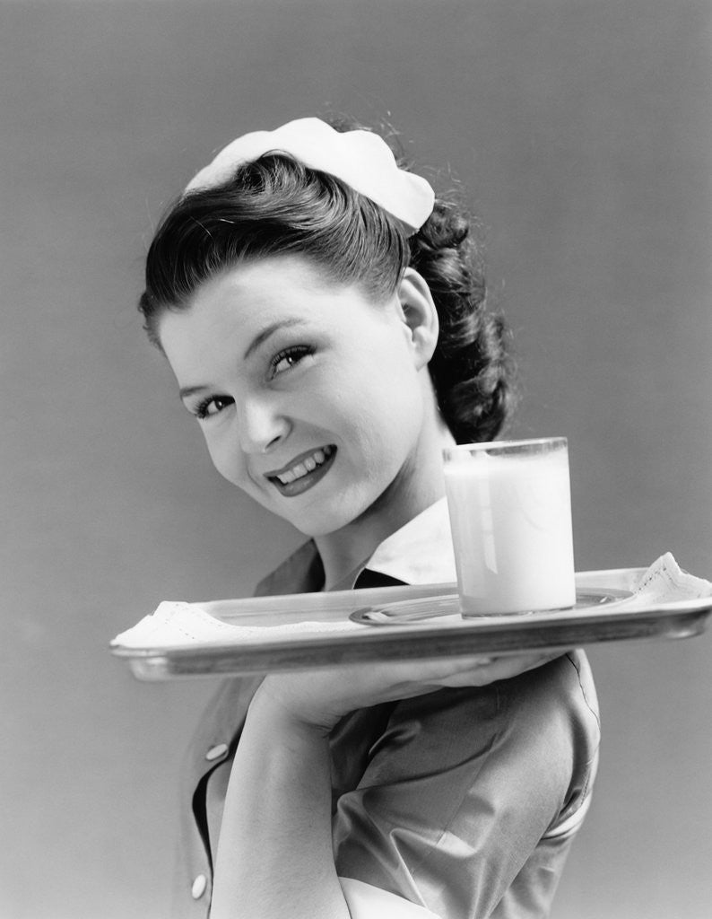 1940s Waitress Carrying Glass Of Milk On Tray