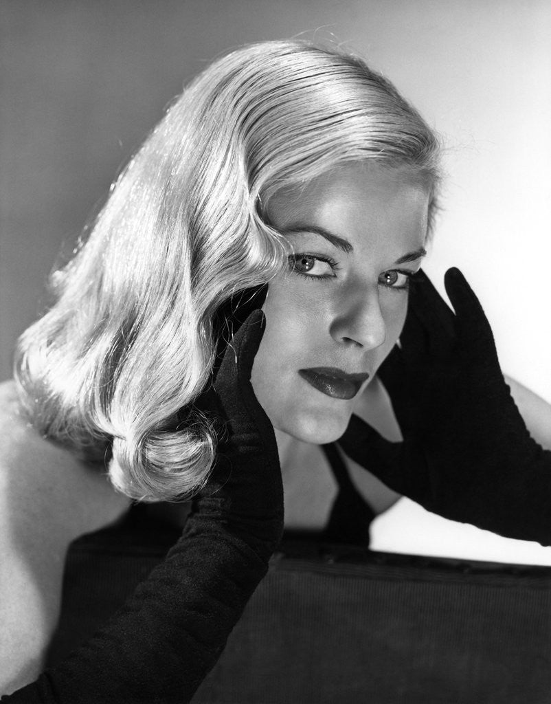 Detail of 1950s Portrait Of Glamorous Woman With Long Black Gloved Hands Touching Cheek by Corbis