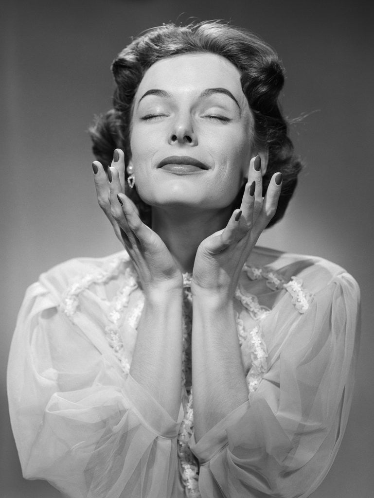 Detail of 1950s Woman Wearing Peignoir With Eyes Closed Hands Held Near Face Ecstatic Facial Expression by Corbis