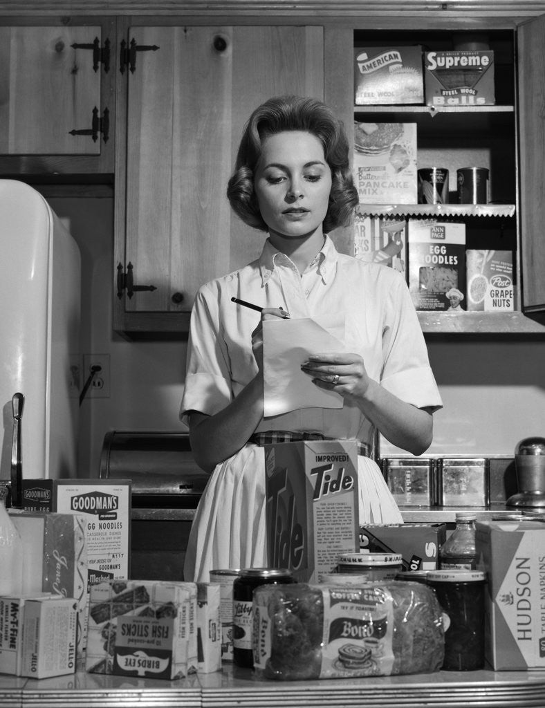 Detail of 1960s Woman Housewife In Kitchen Checking Grocery Food Shopping List by Corbis