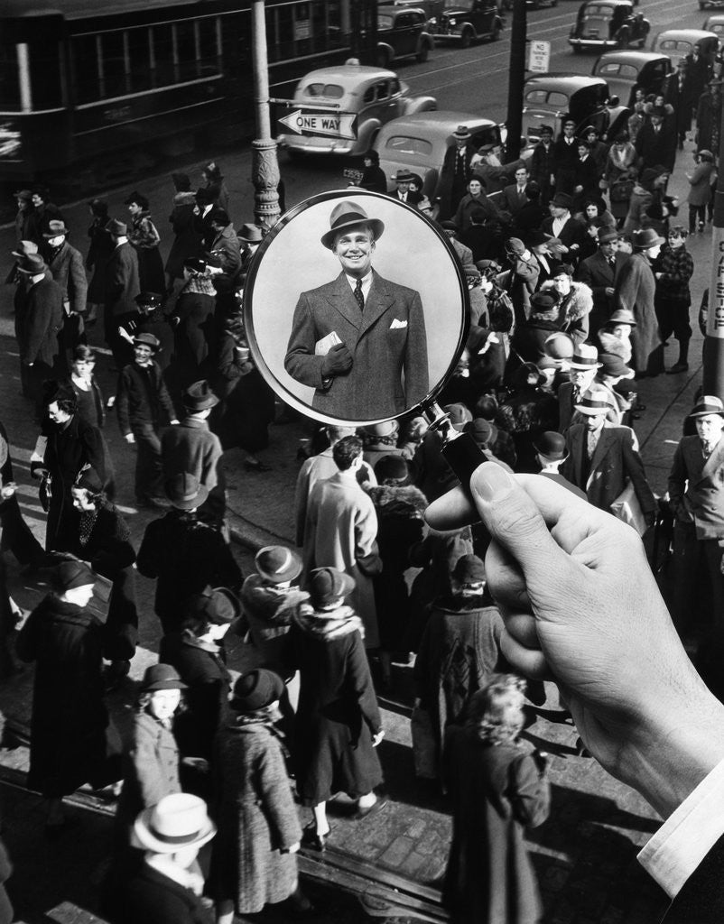 Detail of 1930s 1940s Pedestrian Street Crowd Magnifying Glass Focused On Single Well Dressed Man by Corbis