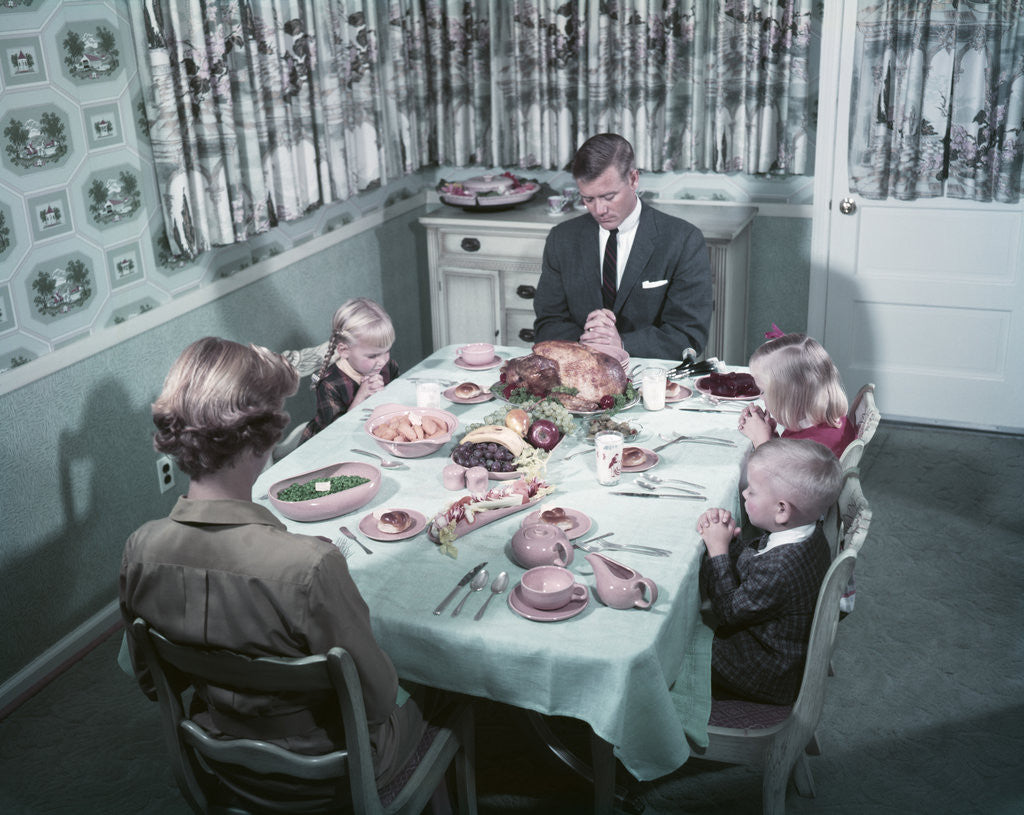 Detail of 1950s Family Of 5 Saying Grace Before Thanksgiving Turkey Dinner Mother Father 3 Children by Corbis