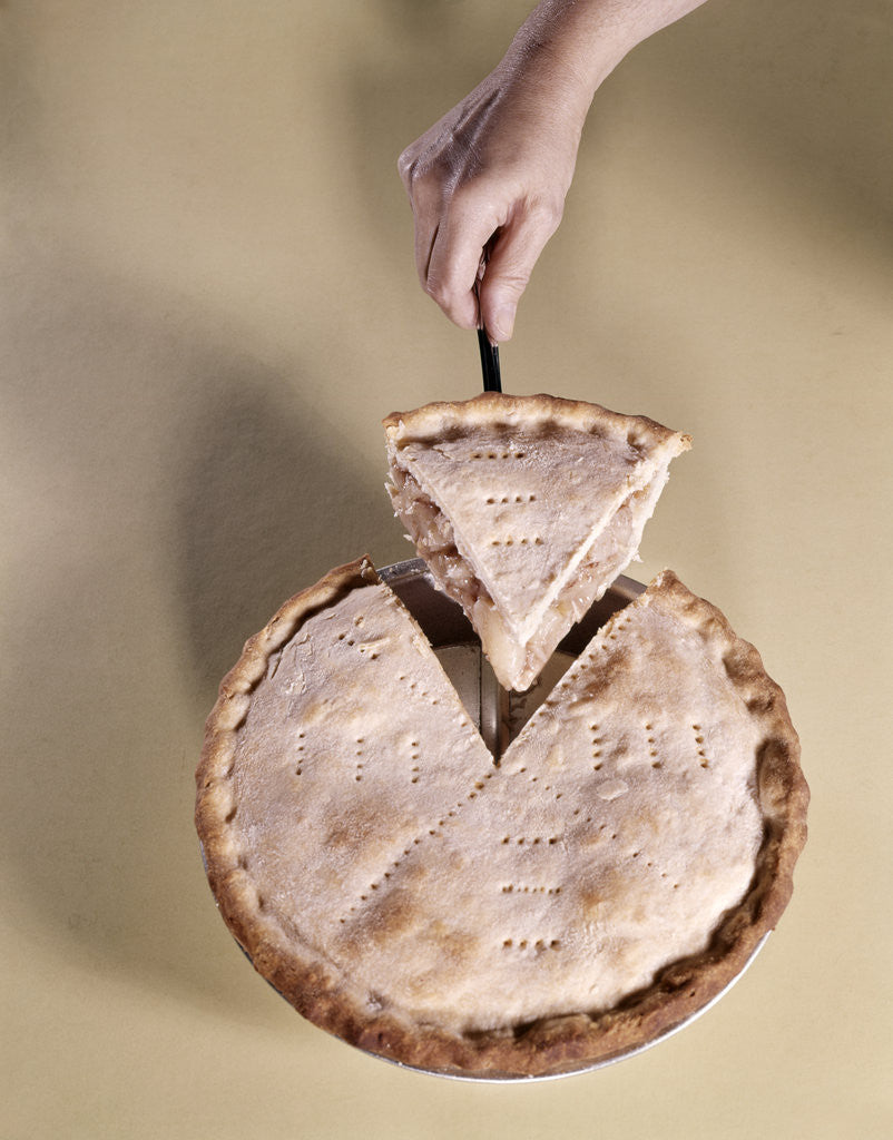Detail of 1970s Hand Serving Wedge Slice Of Apple Pie by Corbis