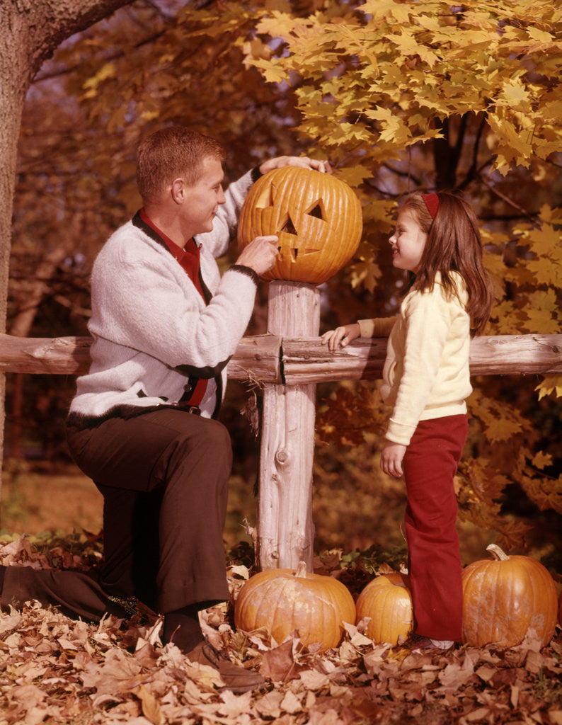Detail of 1960s Man Father And Girl Daughter Carving Halloween Jack-O-Lantern Pumpkin by Corbis