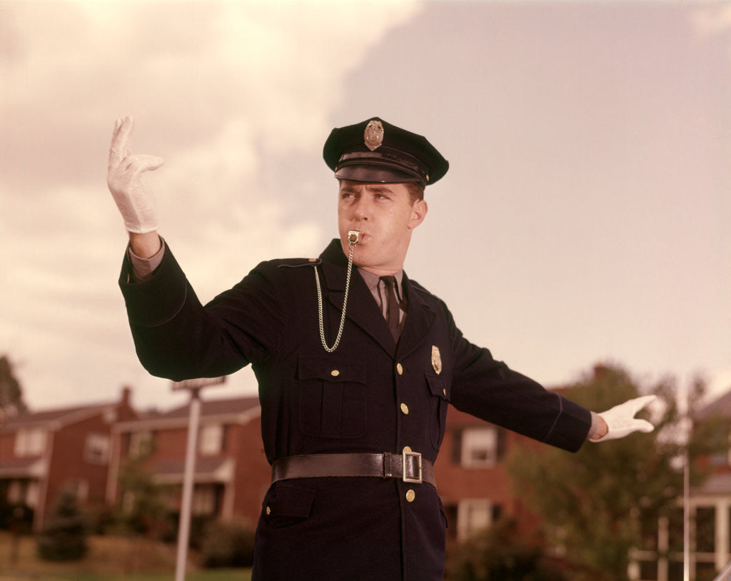 Detail of 1960s Man Policeman Blowing Whistle Directing Traffic by Corbis