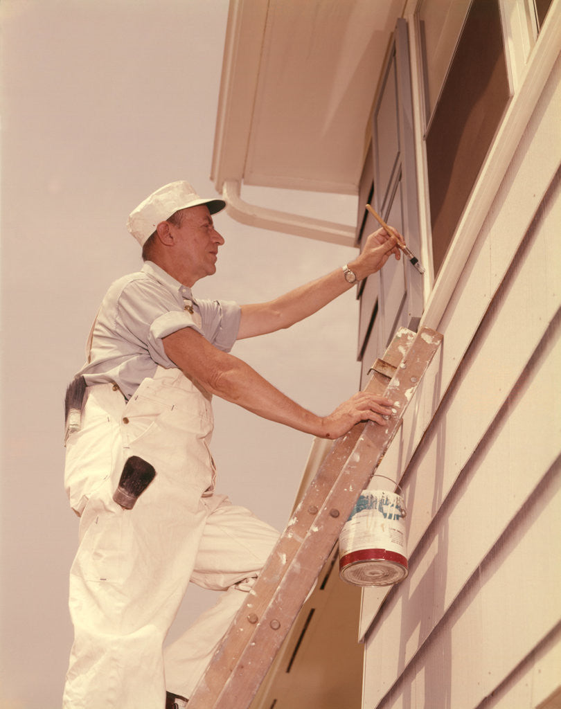 Detail of 1950s 1960s Man House Painter Up Ladder Painting Window Shutter by Corbis
