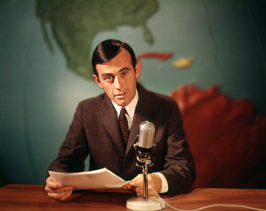 Detail of 1960s Reporter Reading News Into Microphone With Global Map In Background by Corbis