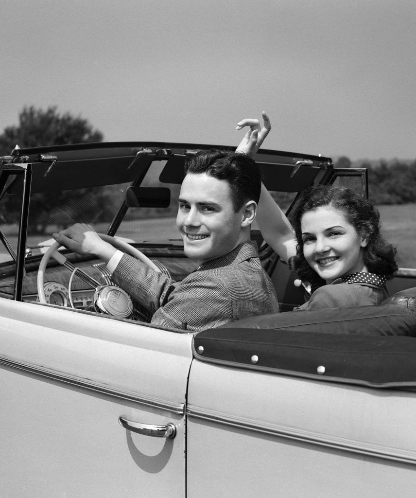 Detail of 1941 1940s Couple Man Woman On A Date Sitting In Pontiac Convertible Automobile by Corbis