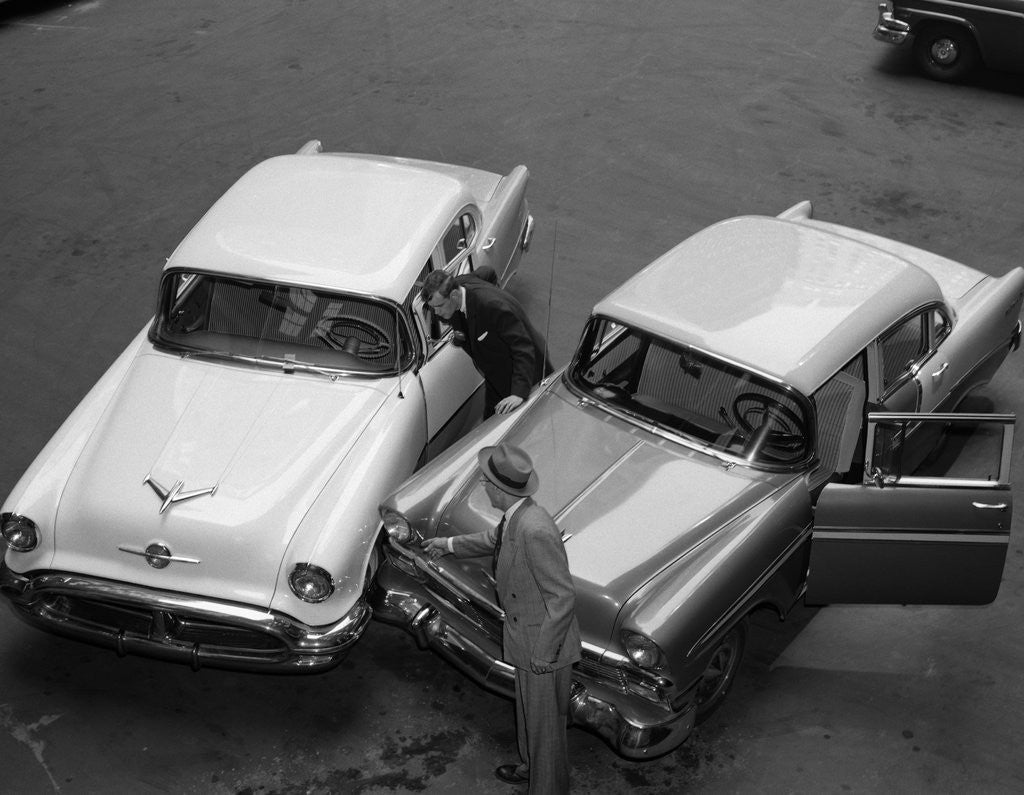 Detail of 1950s 1960s Automobile Fender Bender Accident In Parking Lot by Corbis