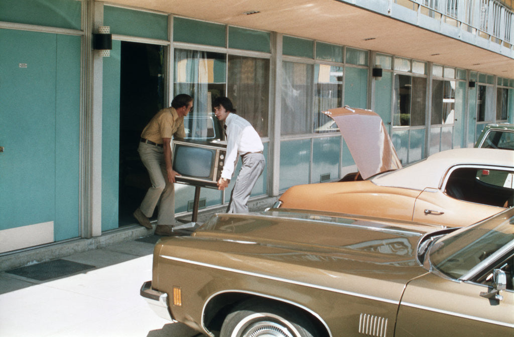 Detail of 1970s Two Men Stealing Televsion Set From Motel Room by Corbis