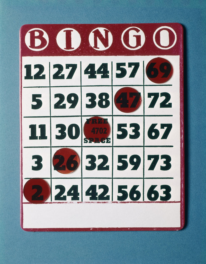 Detail of 1960s Bingo Card With Red Markers In A Winning Game by Corbis