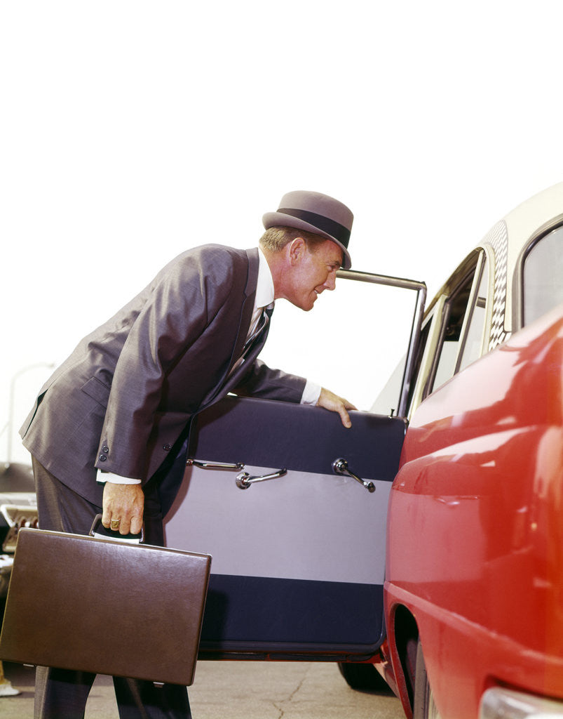 1960s Business Sales Man With Briefcase Getting Into Open Door Red White Checker Taxi Cab