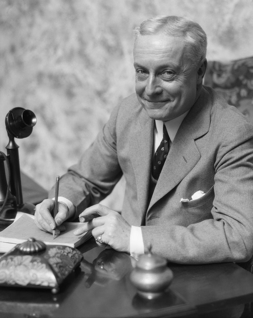 1920s 1930s Man Businessman,Salesman Sitting At Desk Smoking Cigar Writing A Memo by Corbis