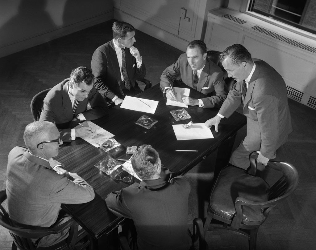 Detail of 1950s Six Men Businessmen Salesmen In Suits Meeting Around Conference Table by Corbis