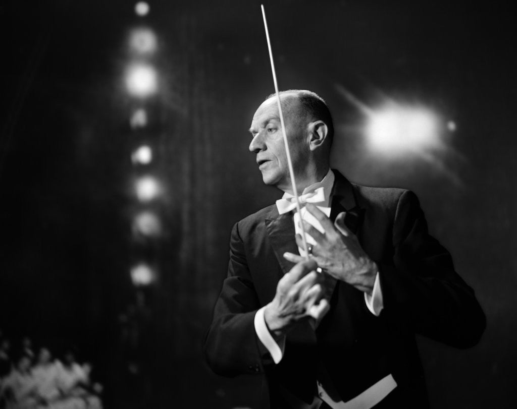 Detail of 1960s 1970s Portrait Of Man In White Tie And Tails Conducting An Orchestra In Symphony Hall by Corbis
