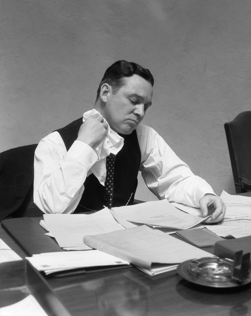 Detail of 1930s Man At Desk In Office Wiping Neck With Handkerchief by Corbis