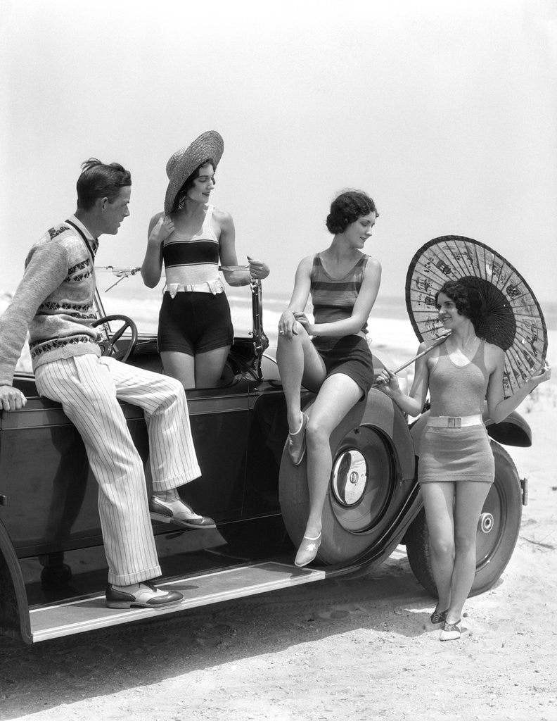 Detail of 1920s 1930s Man And Three Women In Beach Clothes Or Bathing Suits Posing With Car On Running Board by Corbis