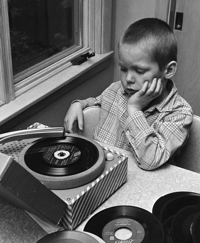 Detail of 1960s 1970s Boy With Buzz Haircut Listening To Music On Portable 45 RPM Phonograph Record Player by Corbis