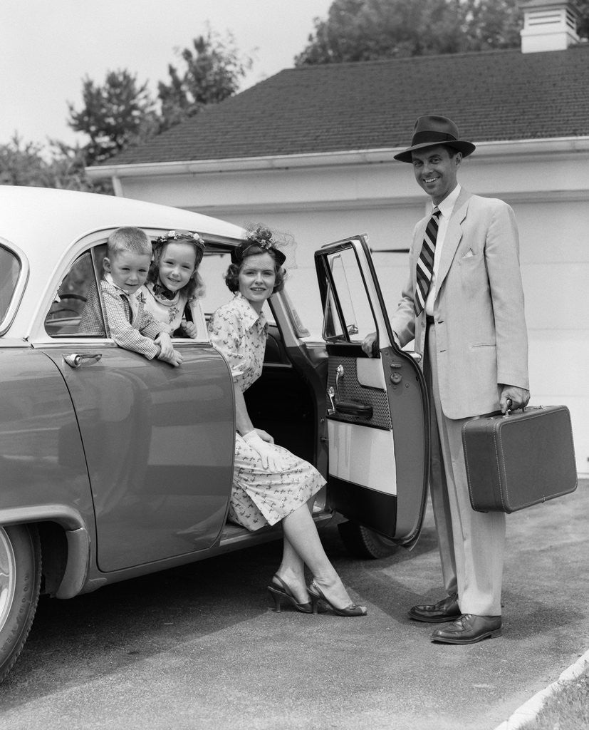 Detail of 1950s Man Opening Automobile Door For Woman by Corbis