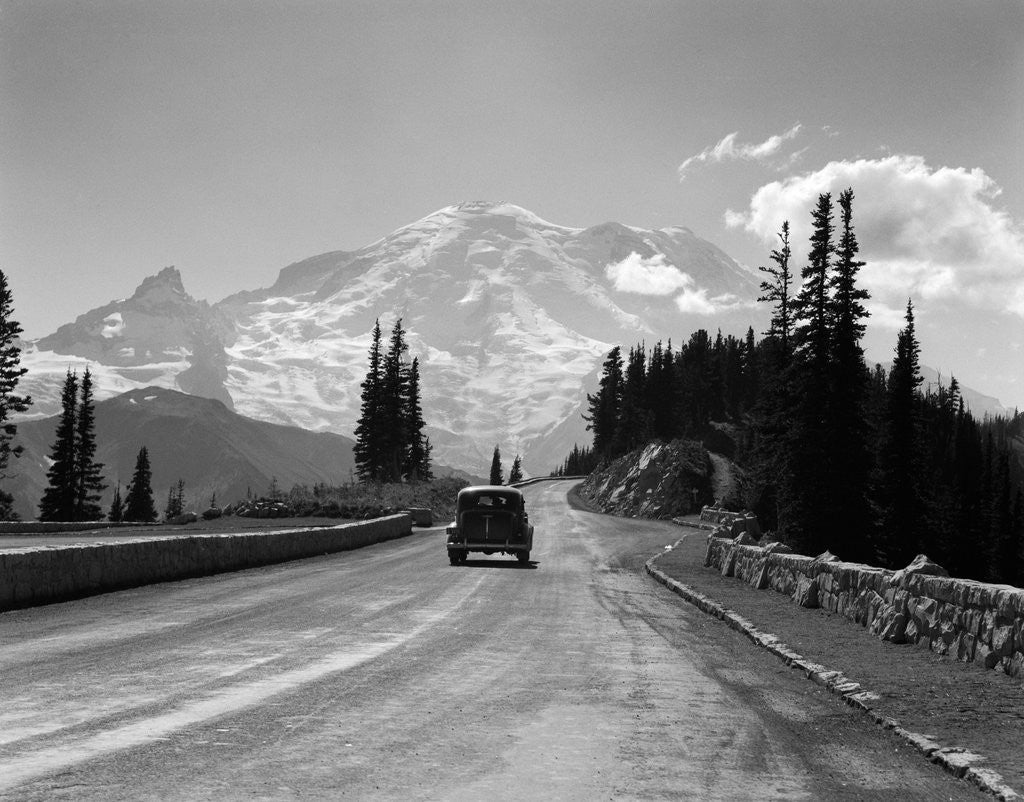 Detail of 1930s Sedan Automobile Driving High Mountain Road Towards Snow Capped Mount Rainier Washington State Usa by Corbis