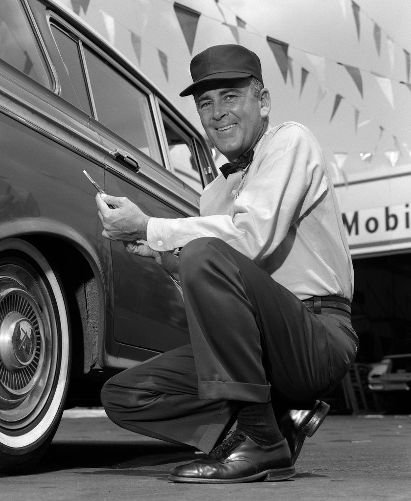 1950s 1960s Gas Station Attendant Checking Tire Pressure