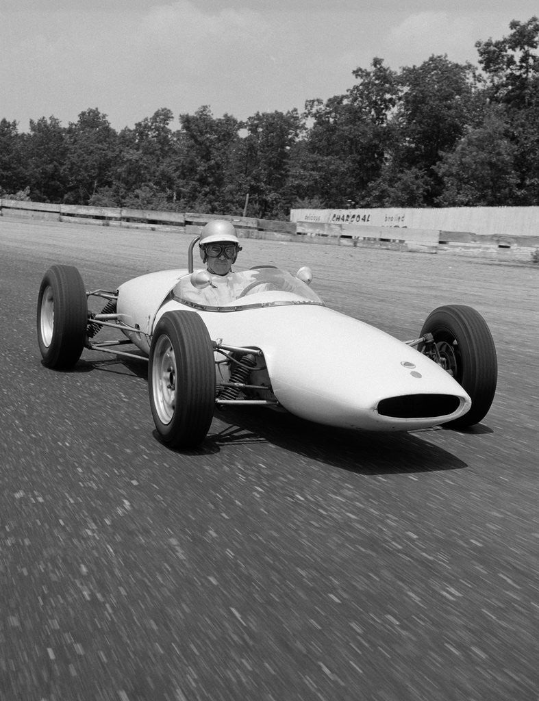 Detail of 1960s Lotus Ford Race Car Speeding Around Track by Corbis