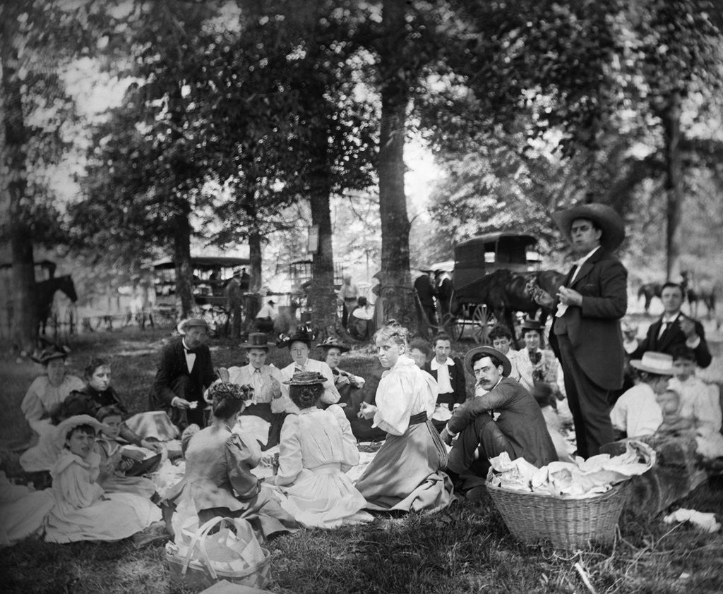 Detail of 1890s 1900s Group Having Picnic In Woods With Horses and Wagons In Background by Corbis
