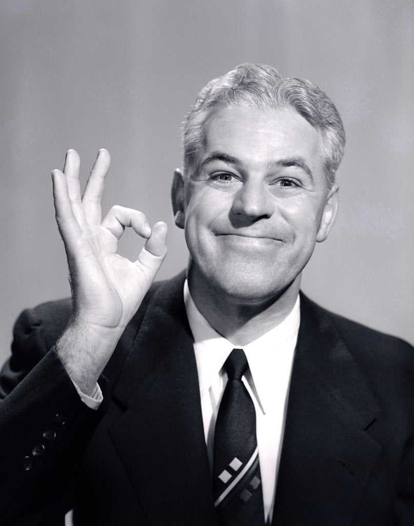 Detail of 1950s Portrait Of Happy Man Businessman Slesman Making An Ok Hand Sign by Corbis