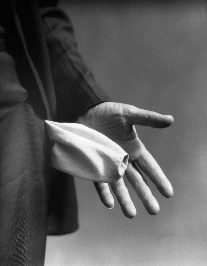 Detail of 1930s Man's Hand Turning Empty Pants Pocket Inside Out by Corbis