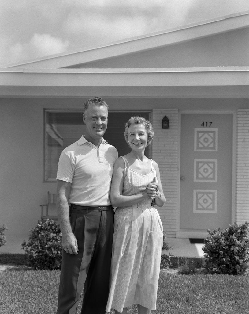 Detail of 1950s Older Man Woman Senior Citizen Standing Together In Retirement Home Front Yard by Corbis