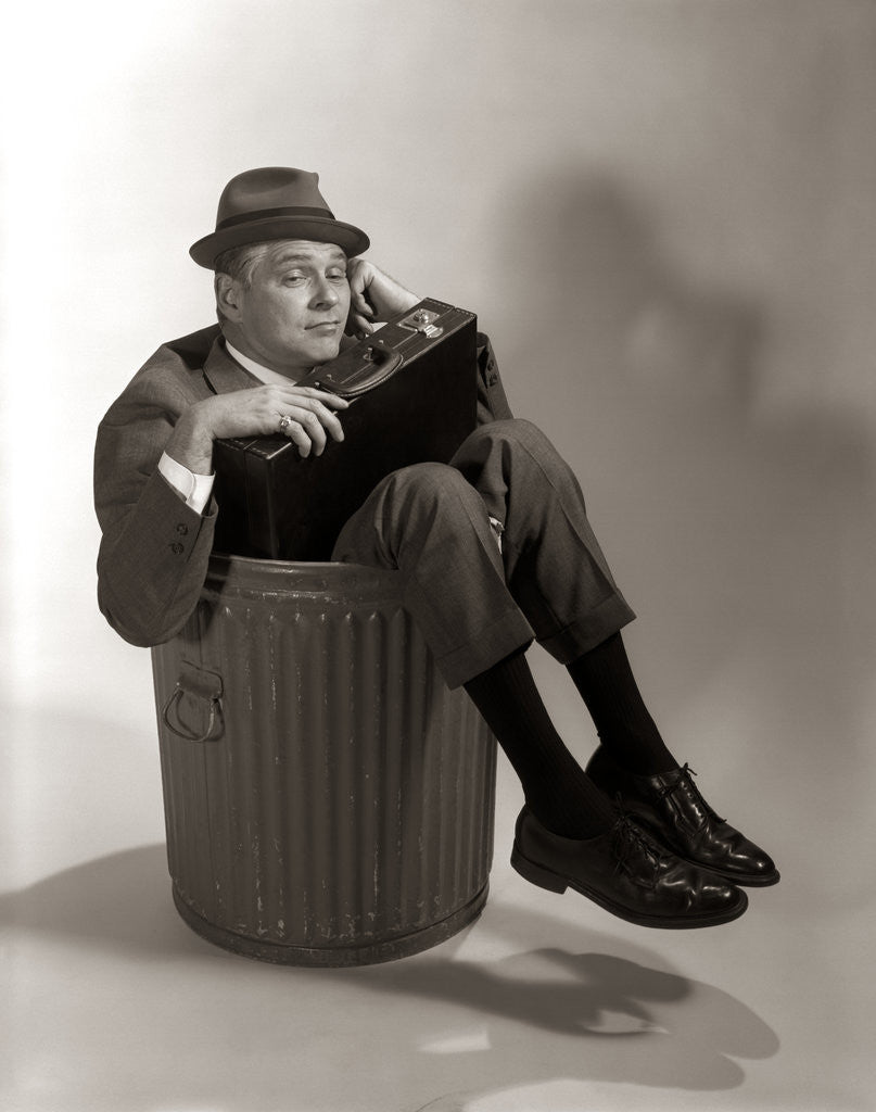 Detail of 1960s Fired Businessman Sitting In Trash Can by Corbis