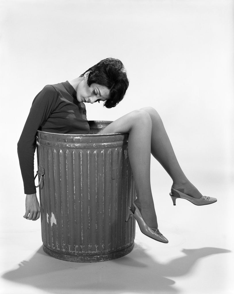 Detail of 1960s Young Woman In Trash Can by Corbis
